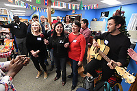 NWA Democrat-Gazette/J.T. WAMPLER Luda Onyshehenko from Ukraine (from left) Fernanda Kanashiro from Brazil, Raya Satibaeva from Uzbekistan and Leandro Walter from Argentina sing Feliz Navidad Wednesday Dec. 4, 2019 at the Ozark Literacy Council's holiday party. The organization has 400 adult students from 50 countries.