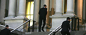 Washington, DC - January 27, 2009 -- United States President Barak Obama walks across West Executive Avenue in the White House to attend a swearing in ceremony in the Eisenhower Office Building on Tuesday, January 27, 2009. .Credit: Dennis Brack - Pool via CNP
