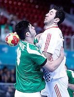 Algeria's Hichem Kaabache (l) and Croatia's Blazenko Lackovic during 23rd Men's Handball World Championship preliminary round match.January 14,2013. (ALTERPHOTOS/Acero) 7NortePhoto