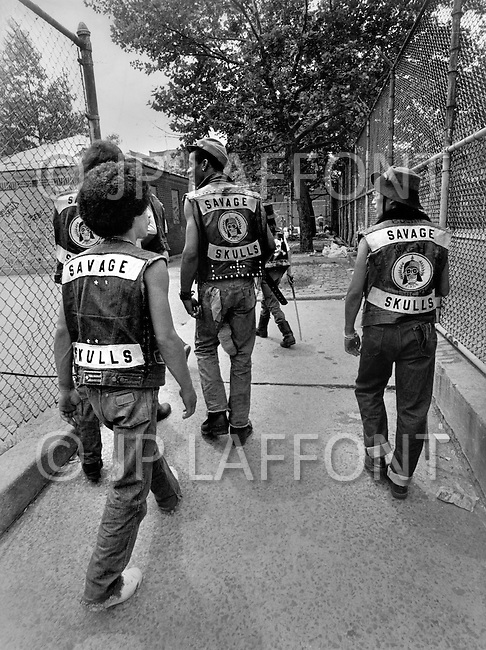 "New York, NY July 20th 1972. New York street gang ""Savage Skulls"". The trademark of the primarily Puerto Rican gang was a sleeveless denim jacket with a skull and crossbones design on the back. Based in the Hunts Point area of the South Bronx, the gang declared war on the drug dealers that operated in the area. Running battles were frequent with rival gangs ""Seven Immortals"" and ""Savage Nomads""."