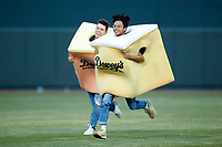 "Fans compete in the ""Dewey's Cake Race"" between innings of the Carolina League game between the Down East Wood Ducks and the Winston-Salem Dash at BB&T Ballpark on May 10, 2019 in Winston-Salem, North Carolina. The Wood Ducks defeated the Dash 9-2. (Brian Westerholt/Four Seam Images)"