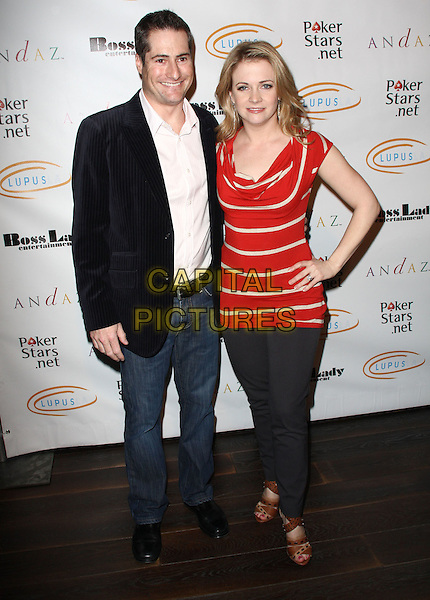"GUEST & MELISSA JOAN HART. Lupus LA Raises Awareness with ""Get Lucky for Lupus"" held At Andaz Hotel, West Hollywood, California, USA..February 25th, 2010.full length red white stripe hands on hips jeans denim brown sandals gold shirt bracelet black jacket shirt.CAP/ADM/KB.©Kevan Brooks/AdMedia/Capital Pictures."