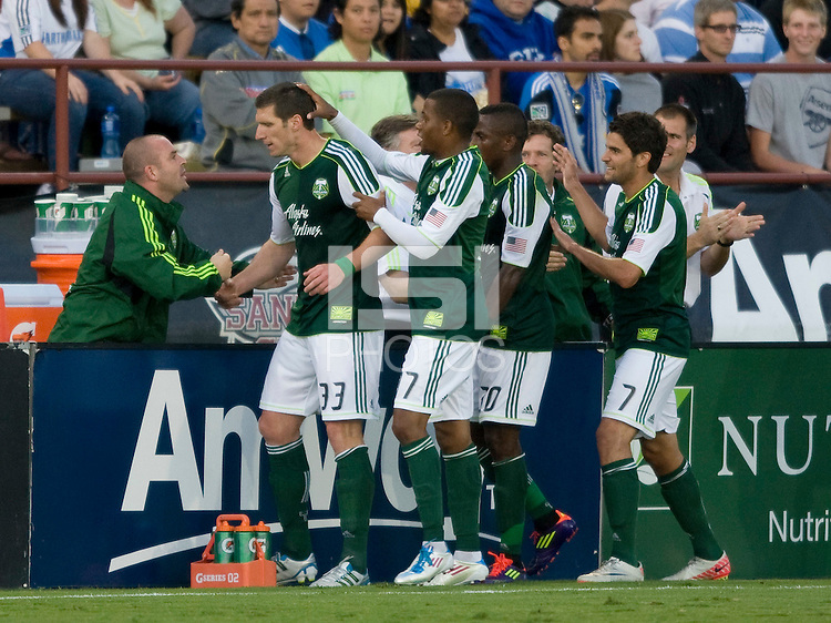Kenny Cooper of Timbers shakes hands with Timbers head coach John Spencer after scoring a goal against the Earthquakes at Buck Shaw Stadium in Santa Clara, California on August 6th, 2011.   San Jose Earthquakes and Portland Timbers tied 1-1.