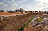 Defensive walls of the Portuguese Fortified city of Mazagan, 16th century, El Jadida, Morocco, minaret of the grand mosque in the distance. El Jadida, previously known as Mazagan (Portuguese: Mazag√£o), was seized in 1502 by the Portuguese, and they controlled this city until 1769. The fortification with its bastions and ramparts is an early example of Renaissance military design. Picture by Manuel Cohen