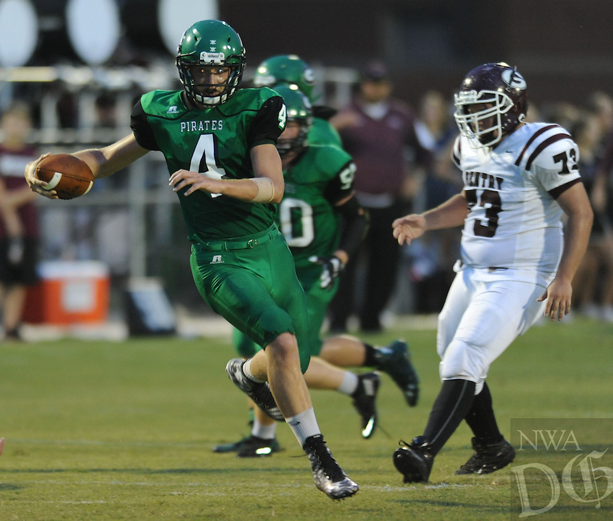 NWA Democrat-Gazette/ANDY SHUPE<br /> Cole Self of Greenland carries the ball through the Gentry defense Friday, Sept. 18, 2015, during the first half of play at Jonathan Ramey Memorial Stadium in Greenland. Visit nwadg.com/photos to see more photographs from the game.