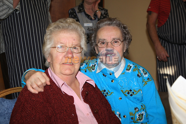 Eileen Finglas and Ann Smith.having there christmas dinner int he Dermot Kierans Centre..Picture Fran Caffrey/www.newsfile.ie.
