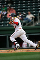 First baseman Nick Longhi (21) of the Greenville Drive bats in a game against the Asheville Tourists on Friday, April 24, 2015, at Fluor Field at the West End in Greenville, South Carolina. Longhi is the No. 27 prospect of the Boston Red Sox, according to Baseball America. Greenville won, 5-2. (Tom Priddy/Four Seam Images)