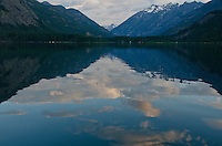 View at the north end of Lake Chelan with sky reflected on water in Stehekin, North Cascades National Park, Washington State