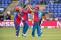 Gulbadin Naib (Afghanistan) and Mohammad Shahzad (Afghanistan) congratulate Mohammad Nabi (Afghanistan) on the wicket of Lahiru Thrimanne (Sri Lanka) during Afghanistan vs Sri Lanka, ICC World Cup Cricket at Sophia Gardens Cardiff on 4th June 2019