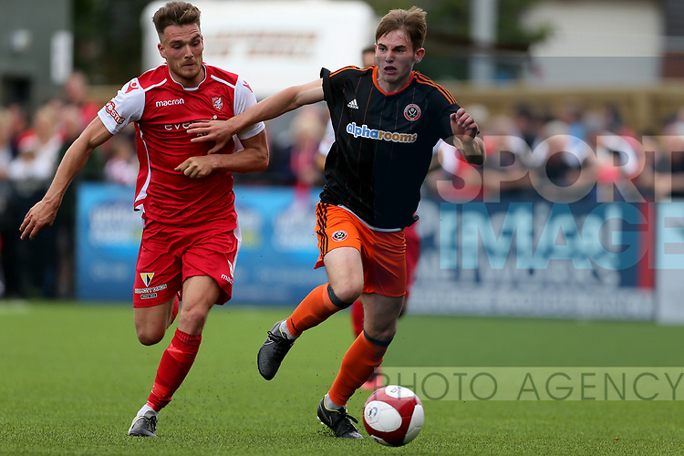 Rhys Norrington Davis of Sheffield Utd with Nathan Valentine of Scarborough during the pre season match at the Flamingo Land Stadium, Scarborough. Picture date 15th July 2017. Picture credit should read: Richard Sellers/Sportimage