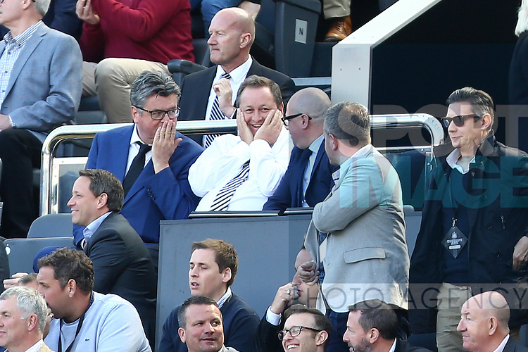 Newcastle owner Mike Ashley looks happy during the Barclays Premier League match at St James' Park. Photo credit should read: Philip Oldham/Sportimage