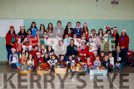 Killlarney Girls Guides presented food hampers to Killarney Lions Club Laurance O'Keeffe and Ronan Doyle on Saturday