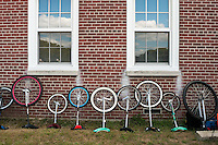 Governor's  Island, NY -  4 September 2010 - Unicycles propped up against a Governor's Island brick building during the New York City Unicycle Festival.