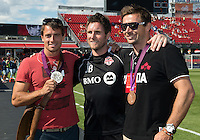 August 18, 2012: Jim Brennan of Toronto FC poses with members of Canada's 2012 Olympic rowing team medal winners before the start of an MLS game between Toronto FC and Sporting Kansas City at BMO Field in Toronto, Ontario Canada..Sporting Kansas City won 1-0.