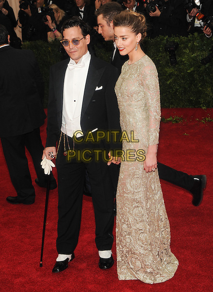 NEW YORK, NY - MAY 5: Johnny Depp and Amber Heard at the Costume Institute Benefit at The Metropolitan Museum of Art on May 5, 2014 in New York. <br /> CAP/MPI/RTNSTV<br /> &copy;RTNSTV/MPI/Capital Pictures