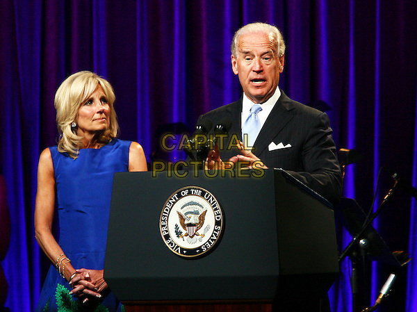 DR. JILL BIDEN & VICE PRESIDENT JOE BIDEN.Sesame Workshop's 8th Annual Benefit Gala at Cipriani 42nd Street, New York City, NY, USA..June 2nd, 2010.half length blue sleeveless dress black suit jacket podium speech married husband wife.CAP/ADM/PZ.©Paul Zimmerman/AdMedia/Capital Pictures.