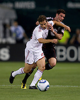 Mathieu Flamini (16) of AC Milan fouls Chris Pontius (13) of D.C. United during a friendly at RFK Stadium in Washington, DC.  AC Milan lost to D.C. United, 3-2.