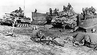 BNPS.co.uk (01202 558833)<br /> USAMHI/BNPS<br /> <br /> A pair of US M24 Chafee light tanks disembark  onto the east bank of the Rhine River. <br /> <br /> Remarkable rarely seen photos of heroic Allied soldiers fighting their way across Europe before crossing the River Rhine 75 years ago feature in a new book.<br /> <br /> They are published in Images of War, Montgomery's Rhine Crossing, which tells the story of the legendary offensive, nicknamed Operation Plunder, in March 1945.<br /> <br /> On the night of March 23, Field Marshal Bernard Montgomery's 21st Army Group launched a massive artillery, amphibious and airborne assault to breach the historic defensive water barrier protecting northern Germany.<br /> <br /> At the same time, the Americans, with the support of the British 6th Airborne Division, set in motion Operation Varsity - involving 16,000 paratroopers - on the east bank of the Rhine. They were dropped here to seize bridges to prevent German reinforcements from contesting the bridgeheads.<br /> <br /> Fierce fighting ensued, with much bloodshed on both sides as the Allies met determined resistance from machine gun nests. But the daring operation proved successful, helping to considerably shorten the war - the Nazis surrendered just six weeks later.