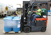 Personnel at Pernod Ricard USA position barrels Friday, March 20, 2020, of newly produced hand sanitizer at the facility in Fort Smith. As of Friday, the company is using its Fort Smith facility to produce and donate hand sanitizer to address supply shortages and help meet national needs as a response to the covid-19 virus. Check out nwaonline.com/2003221aily/ and nwadg.com/photos for a photo gallery.<br /> (NWA Democrat-Gazette/David Gottschalk)