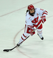 Badger senior, Geena Prough, hits the puck, as the University of Wisconsin women's hockey team tops North Dakota 8-4 on Sunday, 2/13/11, at the Kohl Center in Madison, Wisconsin