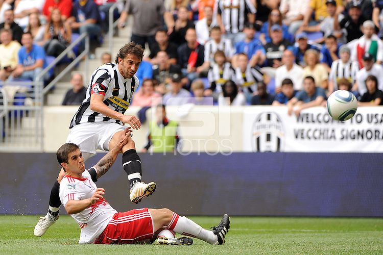 Alessandro Del Piero (10) of Juventus F. C. takes a shot past the tackle of Carlos Mendes (4) of the New York Red Bulls. The New York Red Bulls defeated Juventus F. C. 3-1 during a friendly at Red Bull Arena in Harrison, NJ, on May 23, 2010.