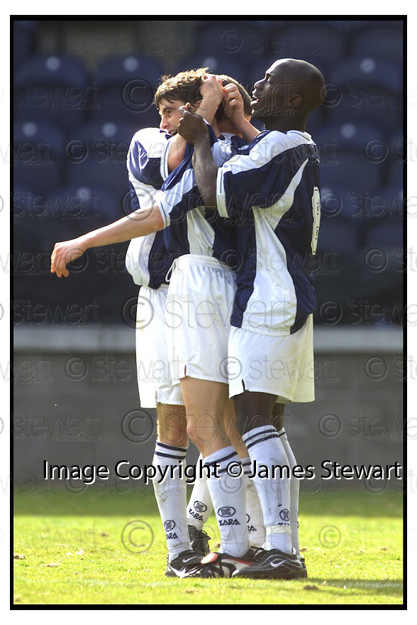 8th April 2000          Copyright Pic : James Stewart .Ref :                           .File Name : stewart05-raith rovers v caley th                        .CARIG DARGO IS CONGRATULATED BY ANSAH OWUSU AND CRAIG MCEWAN AFTER SCORING RAITH'S FIRST GOAL......Payments to :-.James Stewart Photo Agency, Stewart House, Stewart Road, Falkirk. FK2 7AS      Vat Reg No. 607 6932 25.Office : 01324 630007        Mobile : 0421 416997.E-mail : jim@jspa.co.uk.If you require further information then contact Jim Stewart on any of the numbers above.........