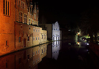 BRUGES, BELGIUM - FEBRUARY 06 : A sidelong view of the Court of Justice buildings with the reflection in the waters of a canal by night on February 06, 2009 in Bruges, West Flanders, Belgium. A dreamlike vision of reflections, shadows and lights of different colors. (Photo by Manuel Cohen)