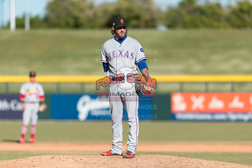 Surprise Saguaros relief pitcher Joe Barlow (19), of the Texas Rangers organization, looks in for the sign during an Arizona Fall League game against the Mesa Solar Sox at Sloan Park on November 15, 2018 in Mesa, Arizona. Mesa defeated Surprise 11-10. (Zachary Lucy/Four Seam Images)