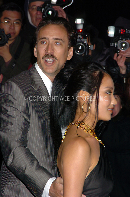 WWW.ACEPIXS.COM . . . . .  ....February 7 2006, New York City....NICLOAS CAGE AND WIFE....Red carpet arrivals at the re-opening of the Versace Fifth Avenue boutique.....Please byline: AJ Sokalner - ACEPIXS.COM.... *** ***..Ace Pictures, Inc:  ..Philip Vaughan (212) 243-8787 or (646) 769 0430..e-mail: info@acepixs.com..web: http://www.acepixs.com