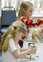 NWA Democrat-Gazette/DAVID GOTTSCHALK Charlotte Jackson, 5, decorates her flower pot Wednesday, March 20, 2019, as she participates in Spring Break Camp at Mount Sequoyah in Fayetteville. The weeklong camp offers different themed activities each day that includes Detectives, Sports, Science/Tech along with free time activities. Campers can register for a day or multiple days.