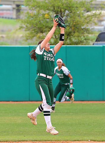 DENTON, TX - APRIL 7:  Karly Williams #11 of University of North Texas mean green softball jumps to make the catch for the out against the of University of Louisiana Lafayette Ragin Cajuns at Lovelace Field on April 7, 2013 in Denton, Texas.  (Photo by Rick Yeatts)