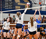 Althoff's Karinna Gall (center) taps the ball over the net in the first game. Also shown are teammates Lauren Borik (left) and Mary Wessel (right). Defending for Columbia is Avrie Barthel.  Althoff defeated Columbia in two games in volleyball action on Thursday August 23, 2018.<br /> Tim Vizer/Special to STLhighschoolsports.com