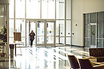 Jr. CSD major Mallory Robinson gets to her class in Lamar Hall. Photo by Kevin Bain/University Communications Photography