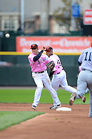 Rochester Red Wings shortstop Doug Bernier #7 attempts to turn a double play as Eric Farris #39 backs up the play during a game against the Columbus Clippers on May 12, 2013 at Frontier Field in Rochester, New York.  Rochester defeated Columbus 5-4 wearing special pink jerseys for Mother's Day.  (Mike Janes/Four Seam Images)