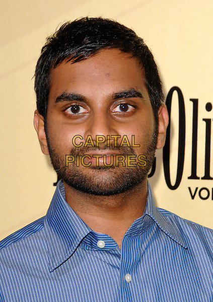 AZIZ ANSARI.Arriving at the Los Angeles premiere of Extract at ArcLight Cinemas in Hollywood, California, USA, .August 24th 2009..portrait headshot blue shirt beard facial hair pinstripe.CAP/ROT.©Lee Roth/Roth Stock/Capital Pictures