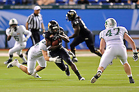 20 December 2011:  FIU wide receiver Mike Jean-Louis (87) attempts to evade Marshall linebacker Billy Mitchell (27) after a reception in the fourth quarter as the Marshall University Thundering Herd defeated the FIU Golden Panthers, 20-10, to win the Beef 'O'Brady's St. Petersburg Bowl at Tropicana Field in St. Petersburg, Florida.