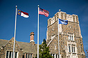 State, Federal and University flags over the Allen Building