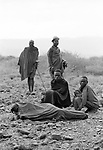 Early morning and Turkana men wake up from a night's sleep.<br /> <br /> nr. Lokitaung  northern Kenya (borders with Sudan and Ethiopia.).
