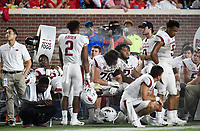 NWA Democrat-Gazette/CHARLIE KAIJO Arkansas Razorbacks players watch the game from the sideline during the second half of a football game, Saturday, September 7, 2019 at Vaught-Hemingway Stadium in Oxford, Miss.