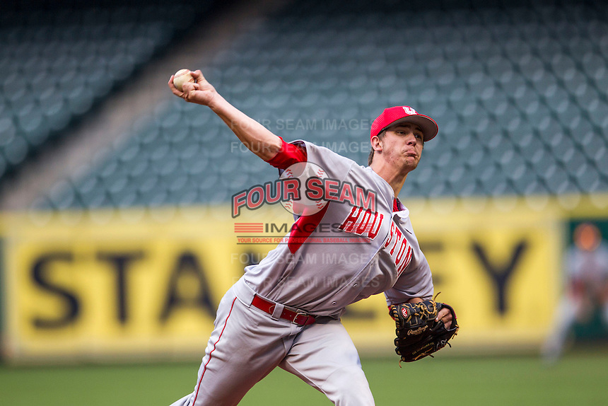 Houston Cougars pitcher Jake Lemoine #26 delivers a pitch to the plate during the NCAA baseball game against the Texas Longhorns on March 1, 2014 during the Houston College Classic at Minute Maid Park in Houston, Texas. The Longhorns defeated the Cougars 3-2. (Andrew Woolley/Four Seam Images)