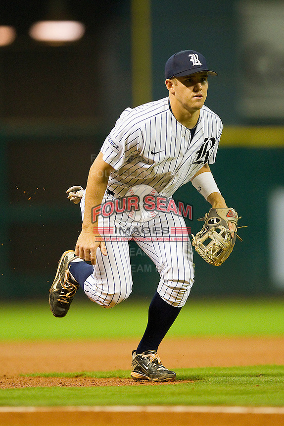 Third baseman Shane Hoelscher #2 of the Rice Owls charges toward home plate against the Texas A&M Aggies at Minute Maid Park on March 5, 2011 in Houston, Texas.  Photo by Brian Westerholt / Four Seam Images