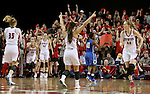VERMILLION, SD, APRIL 2:  Tia Hemiller #4 from the University of South Dakota celebrates a basket in the fourth quarter against Florida Gulf Coast during the WNIT Championship game Saturday afternoon at the Dakota Dome in Vermillion, S.D. (Photo by Dave Eggen/Inertia)