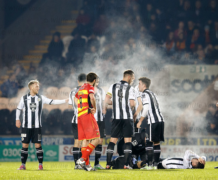 Steam rises from the players as Stuart Carswell lies injured