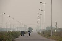 Walking Men in Jing Jin New Town, China.  © LAN