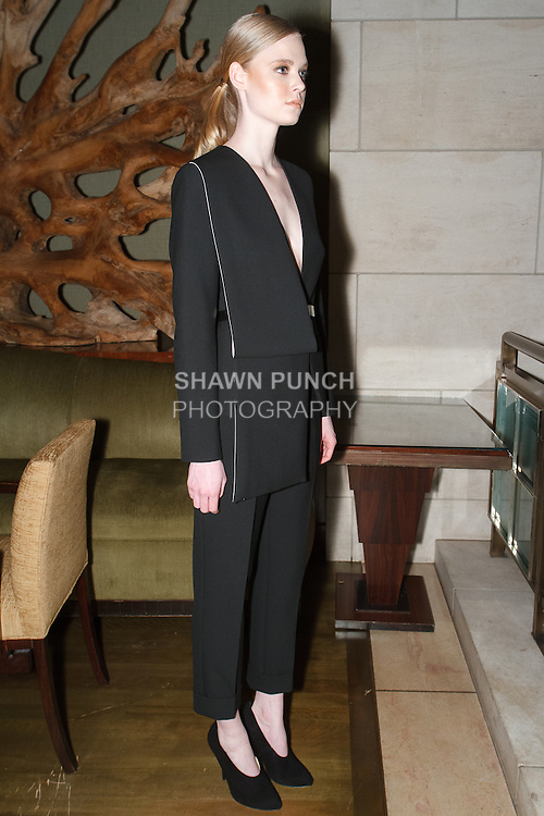 Model poses in an outfit from the Vassa & Co. Pre-Fall 2014 The Black Square collection by Vassa, at The Four Seasons Hotel in New York City, November 19, 2013.