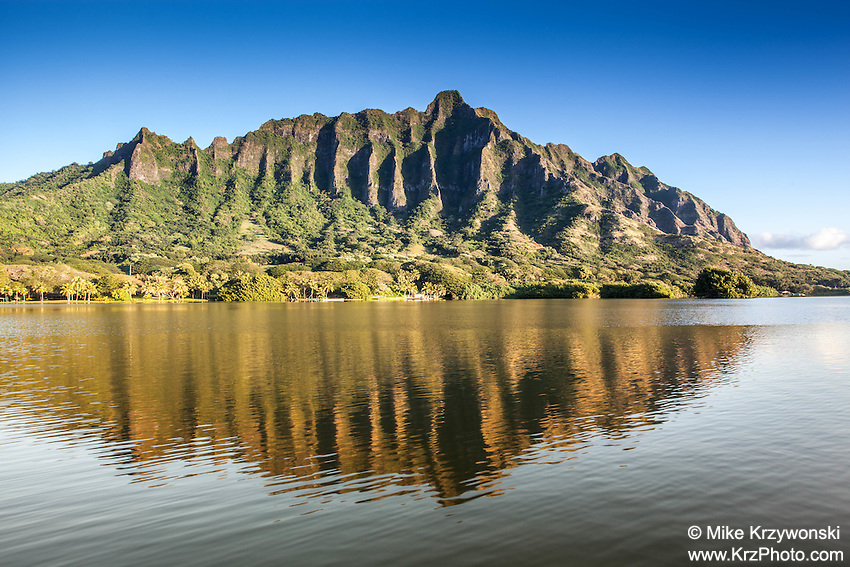 The Ko'olau Mountain Range reflecting off of Moli'i Pond, Secret Island, Oahu