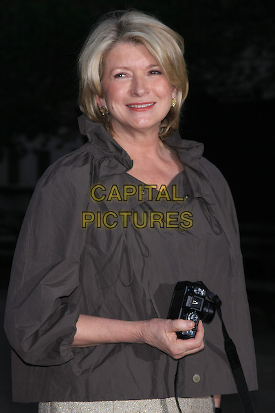 MARTHA STEWART.Attend the 9th Annual Tribeca Film Festival Vanity Fair Party held at the New York State Supreme Courthouse, New York, NY, USA.              .April 20th, 2010.half length grey gray cape jacket beige camera  brown .CAP/LNC.©TOM/LNC/Capital Pictures.