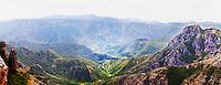 A panoramic view across the tremendously impressive Orin or Bijela Gora mountain tops close to the border to Montenegro on the road between Trebinje and Niksic. Trebinje region. Republika Srpska. Bosnia Herzegovina, Europe.