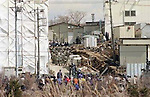 Special investigators search through the Aum Shinrikyo cult buildings in Kamikuishiki, Yamanashi, Japan on March 22, 1995. It is suspected that Aum Shinrikyo was involved in the kidnapping of Kiyoshi Kariya and 2500 police searched 25 locations including this Aum facility in Kamikuishiki and related facilities in Tokyo plus the cult headquaters in Fujinomiya in an attempt to find him. Organic solvents were found in the cult's Kamikuishiki, Yamanashi facilities also linking it to the sarin gas attack on the Tokyo subway. (Photo by Mainichi Newspapers/AFLO)