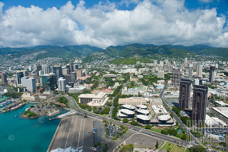 Aerial view from downtown Honolulu and harbor to mountains with Free Trade Zone and Waterfront Plaza in foreground